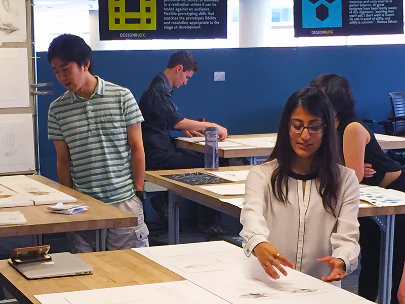 Students explore bio-inspired artwork during an open house for the Design Bloc course.